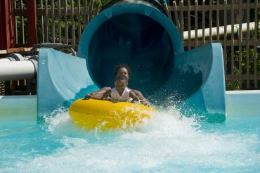 Knoebels Grove Amusement Park. Water slide at the Crystal Pool.