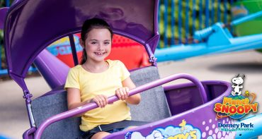 Amusement park girl on ride
